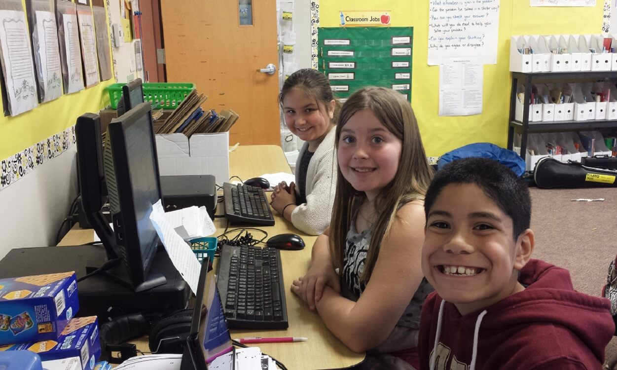 Harmon Elementary fifth graders Brooke Bowers, Mikaella Landa, and AJ Ponce